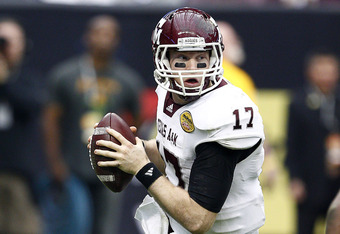 HOUSTON - DECEMBER 31:  Quarterback Ryan Tannehill #17 of Texas A&M Aggies rolls out looking for a receiver against Northwestern Wildcats at Reliant Stadium on December 31, 2011 in Houston, Texas.  (Photo by Bob Levey/Getty Images)