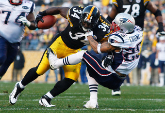 PITTSBURGH, PA - OCTOBER 30:  Rashard Mendenhall #34 of the Pittsburgh Steelers runs through a tackle by Patrick Chung #25 of the New England Patriots during the game on October 30, 2011 at Heinz Field in Pittsburgh, Pennsylvania.  (Photo by Jared Wickerh