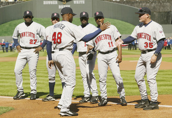 02 Apr 2002 : Torii Hunter #48 of the Minnesota Twins  shakes hands with manager Ron Gardenhire #35 during team line-up before the opening day game against the Kansas City Royals at Kauffman Stadium in Kansas City, Missouri. The Twins won 8-6. DIGITAL IMA