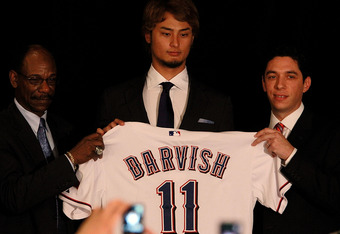 ARLINGTON, TX - JANUARY 20:  Manager Ron Washington and Jon Daniels of the Texas Rangers introduce Yu Darvish to the media at Rangers Ballpark in Arlington on January 20, 2012 in Arlington, Texas.  Darvish and the Texas Rangers came to an agreement on a $