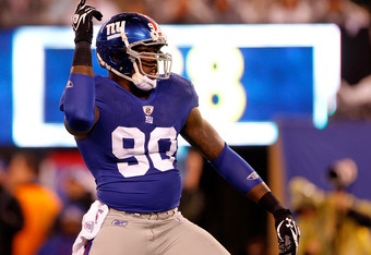 EAST RUTHERFORD, NJ - JANUARY 01:  Jason Pierre-Paul #90 of the New York Giants reacts after a sack in the first quarter against the Dallas Cowboys at MetLife Stadium on January 1, 2012 in East Rutherford, New Jersey.  (Photo by Rich Schultz/Getty Images)