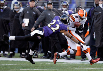 BALTIMORE, MD - DECEMBER 24:  Carlton Mitchell #18 of the Cleveland Browns catches a pass in front of Jimmy Smith #22 of the Baltimore Ravens at M&T Bank Stadium on December 24, 2011 in Baltimore, Maryland.  (Photo by Rob Carr/Getty Images)