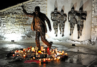 STATE COLLEGE, PA - JANUARY 22: Candles, many burnt out, circle the statue of Joe Paterno, the former Penn State football coach, outside of Beaver Stadium in the early hours of January 22, 2012 in State College, Pennsylvania. The community was reacting to