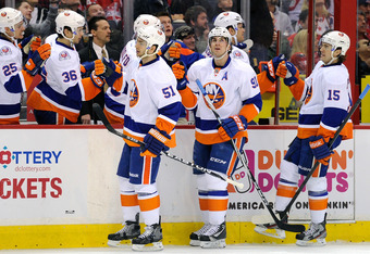 WASHINGTON, DC - JANUARY 17:  John Tavares #91 of the New York Islanders celebrates with teammates after scoring in the first period against the Washington Capitals at the Verizon Center on January 17, 2012 in Washington, DC.  (Photo by Greg Fiume/Getty I