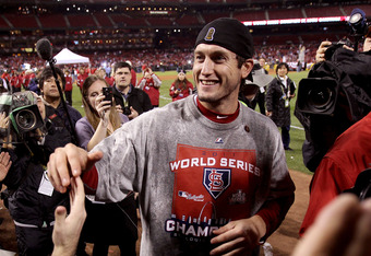 ST LOUIS, MO - OCTOBER 28:  World Series MVP David Freese #23 of the St. Louis Cardinals celebrates with fans after defeating the Texas Rangers 6-2 to win Game Seven of the MLB World Series at Busch Stadium on October 28, 2011 in St Louis, Missouri.  (Pho