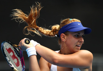 MELBOURNE, AUSTRALIA - JANUARY 21:  Sabine Lisicki of Germany plays a backhand in her third round match against Svetlana Kuznetsova of Russia during day six of the 2012 Australian Open at Melbourne Park on January 21, 2012 in Melbourne, Australia.  (Photo
