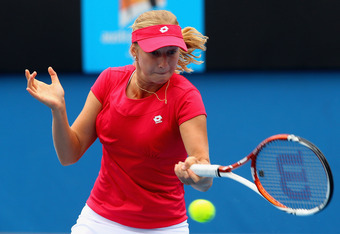 MELBOURNE, AUSTRALIA - JANUARY 21:  Ekaterina Makarova of Russia plays a forehand in her third round match against Vera Zvonareva of Russia during day six of the 2012 Australian Open at Melbourne Park on January 21, 2012 in Melbourne, Australia.  (Photo b
