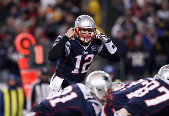 FOXBORO, MA - JANUARY 14:  Tom Brady #12 of the New England Patriots gestures as he calls signals out down the line of scrimmage against the Denver Broncos during their AFC Divisional Playoff Game at Gillette Stadium on January 14, 2012 in Foxboro, Massac