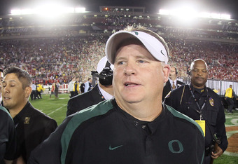 PASADENA, CA - JANUARY 02:  Head coach Chip Kelly of the Oregon Ducks smiles after the Ducks defeated the Wisconsin Badgers 45-38 at the 98th Rose Bowl Game on January 2, 2012 in Pasadena, California.  (Photo by Stephen Dunn/Getty Images)