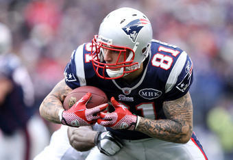 FOXBORO, MA - JANUARY 22:  Aaron Hernandez #81 of the New England Patriots runs with the ball after a pass against the Baltimore Ravens during their AFC Championship Game at Gillette Stadium on January 22, 2012 in Foxboro, Massachusetts.  (Photo by Elsa/G