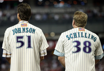 PHOENIX, AZ - SEPTEMBER 10:  Randy Johnson and Curt Schilling, former members of the 2001 Arizona Diamondbacks World Series team stand attended for the National Anthem before the Major League Baseball game against the San Diego Padres at Chase Field on Se