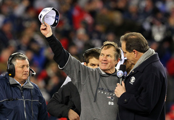 FOXBORO, MA - JANUARY 22:  Head coach Bill Belichick of the New England Patriots talks with commentator Jim Nantz after defeating the Baltimore Ravens in the AFC Championship Game at Gillette Stadium on January 22, 2012 in Foxboro, Massachusetts. The New