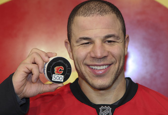 CALGARY, CANADA - JANUARY 7: Jarome Iginla #12 of the Calgary Flames with the puck from his 500th goal scored against the Minnesota Wild during third period NHL action on January 7, 2012 at the Scotiabank Saddledome in Calgary, Alberta, Canada. (Photo by