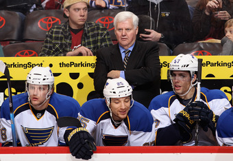 GLENDALE, AZ - DECEMBER 23:  Head coach Ken Hitchcock of the St. Louis Blues watches from the bench during the NHL game against the Phoenix Coyotes at Jobing.com Arena on December 23, 2011 in Glendale, Arizona. The Blues defeated the Coyotes 3-2.  (Photo