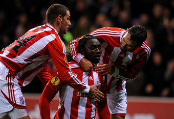 STOKE, ENGLAND - DECEMBER 01:  Kenwyne Jones of Stoke City celebrates scoring his team's first goal with team mates Rory Delap and Danny Higginbotham  (R) during the UEFA Europa League Group E match between Stoke City and FC Dynamo Kyiv at the Britannia S