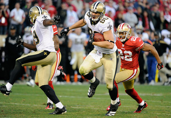 SAN FRANCISCO, CA - JANUARY 14:  Jimmy Graham #80 of New Orleans Saints runs away from Carlos Rogers #22 of the San Francisco 49ers and goes 66 yards for a touchdown in the fourth quarter during the NFC Divisional playoff game at Candlestick Park on Janua