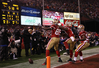 SAN FRANCISCO, CA - JANUARY 22:  (L-R) Vernon Davis #85, Kyle Williams #10 and Kendall Hunter #32 of the San Francisco 49ers celebrate after Davis scored a 28-yard touchdown reception in the thirs quarter against the New York Giants during the NFC Champio