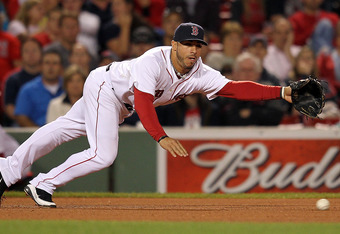 BOSTON, MA - SEPTEMBER 21:  Mike Aviles #3 of the Boston Red Sox prepares to dive for a ground ball during a game with Baltimore Orioles at Fenway Park September 21, 2011 in Boston, Massachusetts. (Photo by Jim Rogash/Getty Images)
