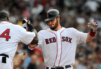 BOSTON, MA - SEPTEMBER 3:  Jarrod Saltalamacchia # 39 of the Boston Red Sox gets congratulated after hitting a two run homer in the fourth inning against the Texas Rangers at Fenway Park on September 3, 2011 in Boston, Massachusetts. (Photo by Darren McCo