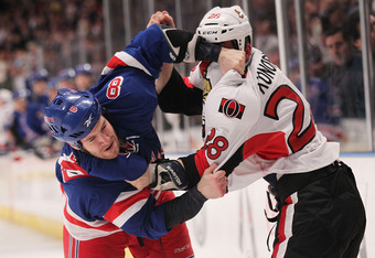 NEW YORK, NY - JANUARY 12:  Brandon Prust #8 of the New York Rangers fights with Zenon Konopka #28 of the Ottawa Senators at Madison Square Garden on January 12, 2012 in New York City.  (Photo by Nick Laham/Getty Images)