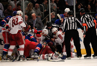 NEW YORK, NY - JANUARY 10: The New York Rangers and the Phoenix Coyotes brawl at Madison Square Garden on January 10, 2012 in New York City.  (Photo by Chris Trotman/Getty Images)