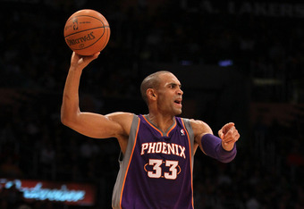 LOS ANGELES, CA - JANUARY 10:  Grant Hill #33 of the Phoenix Suns holds the ball as he directs the offense against the Los Angeles Lakers at Staples Center on January 10, 2012 in Los Angeles, California.  The Lakers won 99-83. NOTE TO USER: User expressly