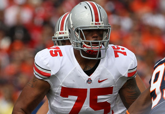 CHAMPAIGN, IL - OCTOBER 02: Mike Adams #75 of the Ohio State Buckeyes prepares to block against the Illinois Fighting Illini at Memorial Stadium on October 2, 2010 in Champaign, Illinois. Ohio State defeated Illinois 24-13. (Photo by Jonathan Daniel/Getty