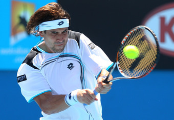 MELBOURNE, AUSTRALIA - JANUARY 19:  David Ferrer of Spain plays a backhand in his second round match against Ryan Sweeting of the United States during day four of the 2012 Australian Open at Melbourne Park on January 19, 2012 in Melbourne, Australia.  (Ph