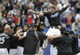 Brett Lawrie is mobbed at home plate as he walks off the Jays with a HR