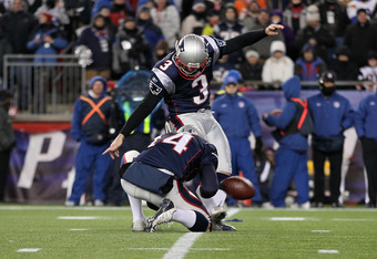 FOXBORO, MA - JANUARY 14:  Stephen Gostkowski #3 of the New England Patriots attempts a kick from the hold of Zoltan Mesko #14 against the Denver Broncos during their AFC Divisional Playoff Game at Gillette Stadium on January 14, 2012 in Foxboro, Massachu