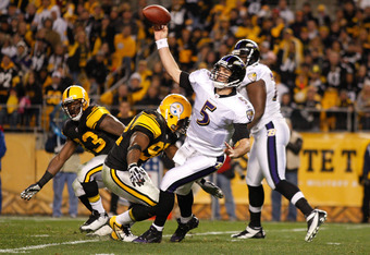 PITTSBURGH, PA - NOVEMBER 06:  Joe Flacco #5 of the Baltimore Ravens throws the ball just as he is being hit by James Harrison #92  of the Pittsburgh Steelers during the game on November 6, 2011 at Heinz Field in Pittsburgh, Pennsylvania.  (Photo by Jared