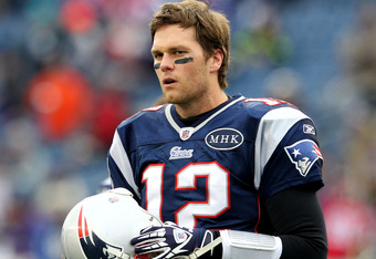 FOXBORO, MA - JANUARY 22:  Tom Brady #12 of the New England Patriots looks on against the Baltimore Ravens during their AFC Championship Game at Gillette Stadium on January 22, 2012 in Foxboro, Massachusetts.  (Photo by Jim Rogash/Getty Images)