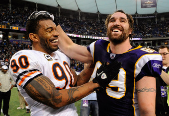MINNEAPOLIS, MN - JANUARY 1: Julius Peppers #90 of the Chicago Bears and Jared Allen #69 of the Minnesota Vikings speak after their game on January 1, 2012 at Mall of America Field at the Hubert H. Humphrey Metrodome in Minneapolis, Minnesota. The Bears d