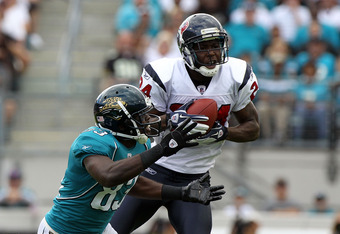 JACKSONVILLE, FL - NOVEMBER 27:   Johnathan Joseph #24 of the Houston Texans intercepts a pass intended for Jason Hill #83 of the Jacksonville Jaguars during the game at EverBank Field on November 27, 2011 in Jacksonville, Florida.  (Photo by Sam Greenwoo