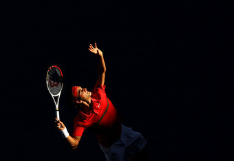 MELBOURNE, AUSTRALIA - JANUARY 24:  Roger Federer of Switzerland serves in his quarter final match against Juan Martin Del Potro of Argentina during day nine of the 2012 Australian Open at Melbourne Park on January 24, 2012 in Melbourne, Australia.  (Phot