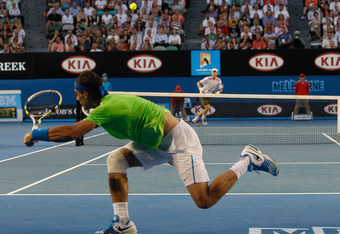MELBOURNE, AUSTRALIA - JANUARY 24:  Rafael Nadal of Spain plays a shot in his quarter final match against Tomas Berdych of the Czech Republic during day nine of the 2012 Australian Open at Melbourne Park on January 24, 2012 in Melbourne, Australia.  (Phot