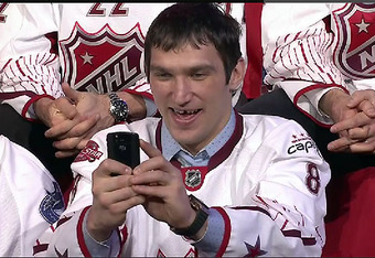 ... or this gem of him snapping a picture of Phil Kessel as he was the last one picked at the 2011 Fantasy Draft?