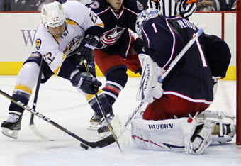 COLUMBUS, OH - OCTOBER 7:  Steve Mason #1 of the Columbus Blue Jackets makes a save on Jordin Tootoo #22 of the Nashville Predators during the game at Nationwide Arena on October 7, 2011 in Columbus, Ohio.  The Predators defeated the Blue Jackets 3-2.  (P