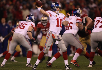 SAN FRANCISCO, CA - JANUARY 22: Eli Manning #10 of the New York Giants passes against the San Francisco 49ers during the second half of the NFC Championship Game at Candlestick Park on January 22, 2012 in San Francisco, California.  (Photo by Ezra Shaw/Ge