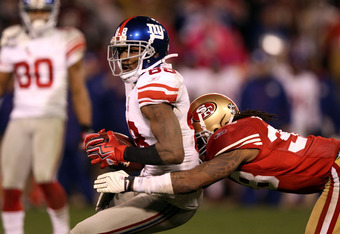 SAN FRANCISCO, CA - JANUARY 22:  Hakeem Nicks #88 of the New York Giants makes a catch against Dashon Goldson #38 of the San Francisco 49ers during the NFC Championship Game at Candlestick Park on January 22, 2012 in San Francisco, California.  (Photo by
