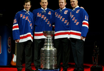 NEW YORK - FEBRUARY 03:  Adam Graves #9 (2nd L) poses with former New York Rangers players Mike Richter (L) Brian Leetch (2nd R) and Mark Messier after his jersey was raised to the rafters of Madison Square Garden during a ceremony prior to a game between