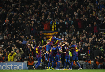 BARCELONA, SPAIN - JANUARY 25:  FC Barcelona players celebrate after Dani Alves of FC Barcelona scored their second goal during the Copa del Rey quarter final second leg match between FC Barcelona and Real Madrid at Camp Nou on January 25, 2012 in Barcelo