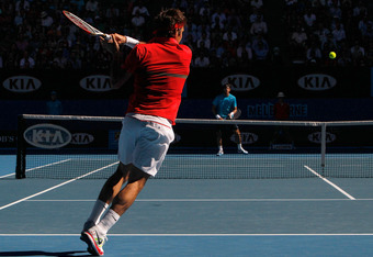MELBOURNE, AUSTRALIA - JANUARY 24:  Roger Federer of Switzerland plays a forehand in his quarter final match against Juan Martin Del Potro of Argentina during day nine of the 2012 Australian Open at Melbourne Park on January 24, 2012 in Melbourne, Austral