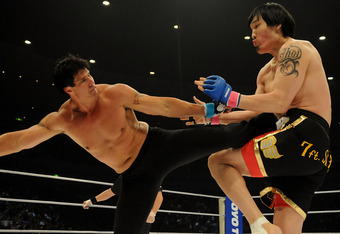 YOKOHAMA, JAPAN - MAY 26:  Former Oakland Athletics slugger Jose Canseco (L) fights with Choi Hong-man at first Round of Super Hulk Tournament during Dream.9 at Yokohama Arena on May 26, 2009 in Yokohama, Kanagawa, Japan. Canseco lost at 1 minute 17 secon
