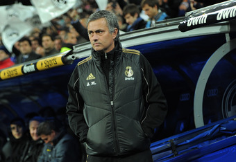 MADRID, SPAIN - JANUARY 18:  Head coach Jose Mourinho of Real Madrid waits for the start of the Copa del Rey quarter final match between Real Madrid and Barcelona at Estadio Santiago Bernabeu on January 18, 2012 in Madrid, Spain.  (Photo by Jasper Juinen/