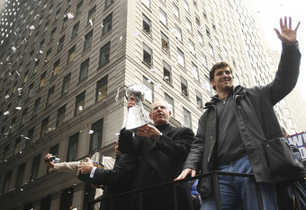 NEW YORK - FEBRUARY 05:  New York Giants coach Tom Coughlin (L) and quarterback Eli Manning wave to fans during the New York Giants Superbowl XLII victory parade February 5, 2008 in New York City.  (Photo by Chris McGrath/Getty Images)