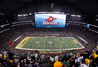 ARLINGTON, TX - FEBRUARY 06:  A Doritos ad is displayed on the screen during Super Bowl XLV at Cowboys Stadium on February 6, 2011 in Arlington, Texas.  (Photo by Tom Pennington/Getty Images)