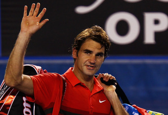MELBOURNE, AUSTRALIA - JANUARY 26:  Roger Federer of Switzerland waves to the crowd after losing his semifinal match against Rafael Nadal of Spain during day eleven of the 2012 Australian Open at Melbourne Park on January 26, 2012 in Melbourne, Australia.