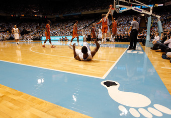 CHAPEL HILL, NC - DECEMBER 21:  Harrison Barnes #40 of the North Carolina Tar Heels falls to the ground against the Texas Longhorns during their game at the Dean Smith Center on December 21, 2011 in Chapel Hill, North Carolina.  (Photo by Streeter Lecka/G