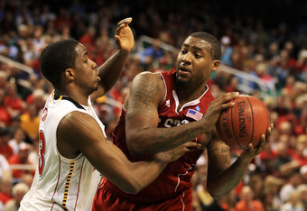 GREENSBORO, NC - MARCH 10:  Richard Howell #1 of the North Carolina State Wolfpack looks to pass against Dino Gregory #33 of the Maryland Terrapins during the second half of the game in the first round of the 2011 ACC men's basketball tournament at the Gr